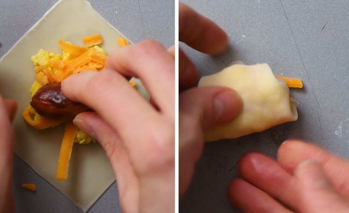 uncooked wonton wrapper being filled with a cocktail sausage and wrapped up