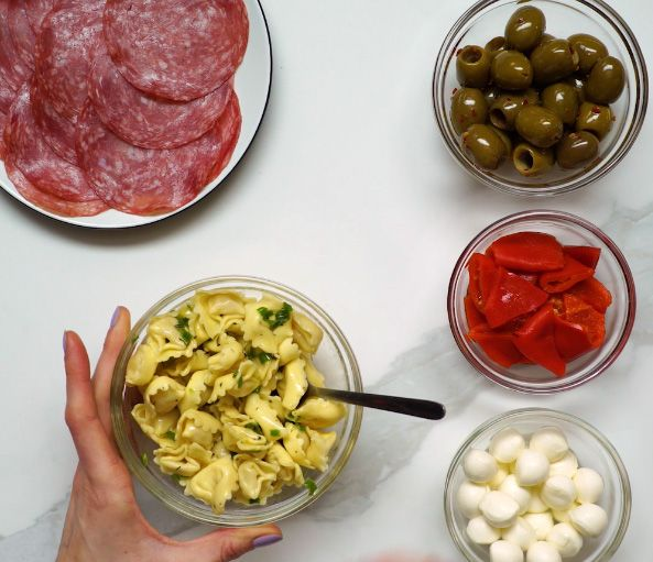 prepared antipasto ingredients in glass bowls