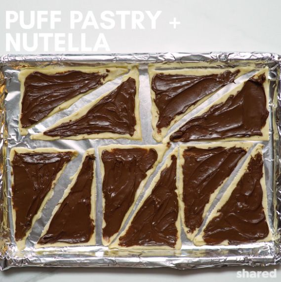 nutella spread on triangles of uncooked puff pastry