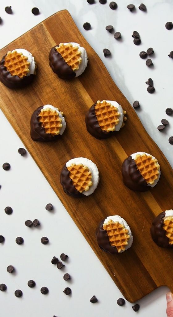 waffle wafer smore sandwiches on a wooden serving tray