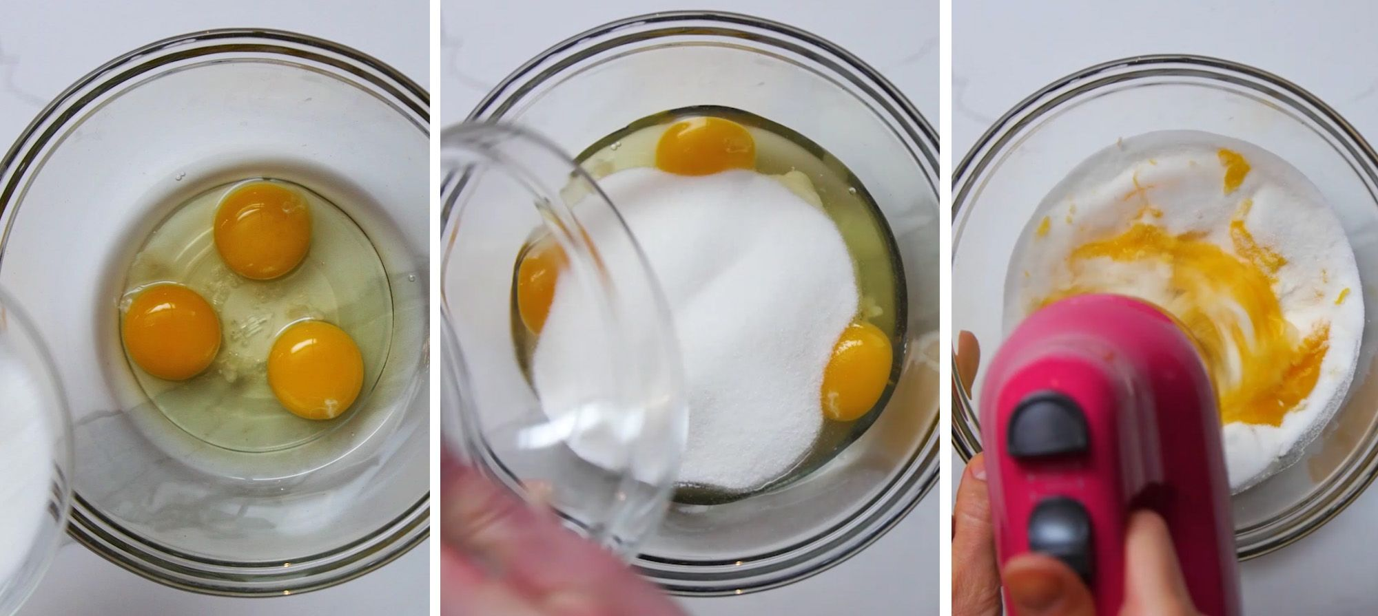 Eggs and sugar being blended in a glass mixing bowl